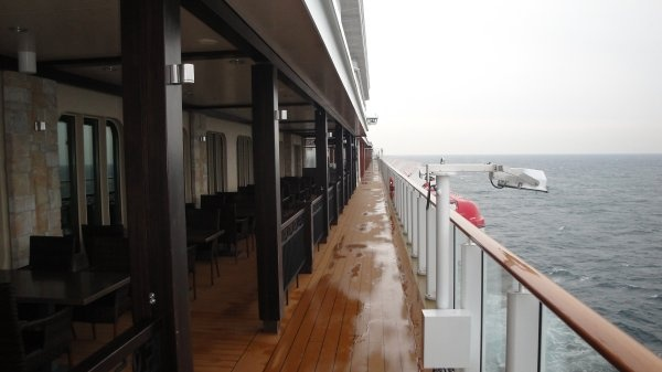 This is the Waterfront on deck 8. It wraps around almost the entire ship and contains outdoor dining venues and entertainment.