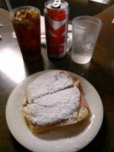 Mallorca Sandwich.  Ham and cheese on a sweet bun dusted with powdered sugar.
