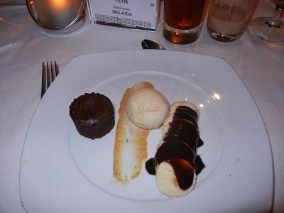 Warm chocolate cake with vanilla ice cream and chocolate covered banana