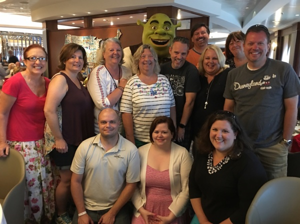 Shrek with Travel Counselors affiliated with The Magic For Less Travel and Magically Carefree Vacations - DreamWorks Rise & Dine Character Dining on Royal Caribbean Oasis of the Seas