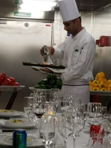 Chef Santosh finishing the quail prior to plating it.