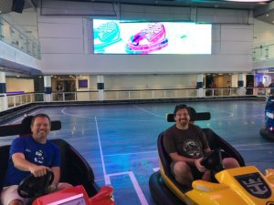 Steve and Ric, agents of The Magic For Less having fun on the bumper cars!